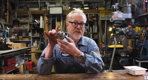 Adam Savage with a Master Replica Thermal Detonator