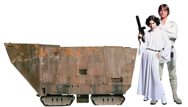 1/18 scale mockup of Sandcrawler next to Luke and Leia